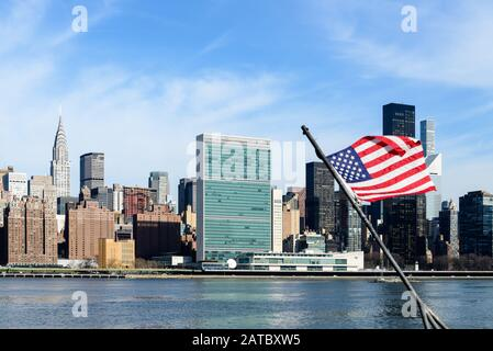 Panoramic view of Murray Hill in midtown Manhattan with United Nation headquarters and Chrysler building from Brooklyn - Stock Photo
