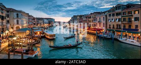 Panorama of Venice at night, Italy. Beautiful cityscape of Venice in evening. Panoramic view of Grand Canal at dusk. It is one of the main travel attr Stock Photo
