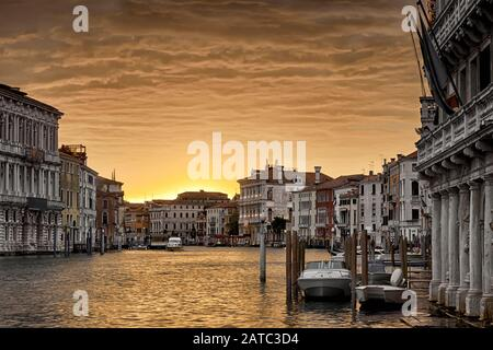 Venice at sunset, Italy. Nice view of the Grand Canal in twilight. Venice cityscape in evening golden light. Panorama of Venice waterfront at dusk. Be Stock Photo
