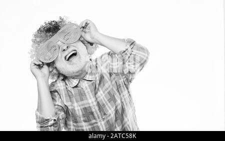 Man senior bearded cheerful person wear colorful wig and sunglasses. Having fun. Funny lifestyle. Fun and entertainment. Comic grandfather concept. Nice joke. Grandpa always fun. Elderly clown. - Stock Photo