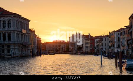 Venice at sunset, Italy. Panorama of the famous Grand Canal at night. Landscape of the Venice city in twilight. Scenery of sunny street in the Venice - Stock Photo