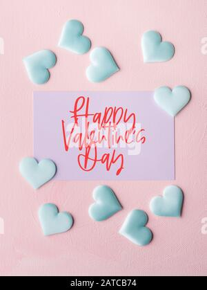 Happy Valentine's day greetings on pastel card - Stock Photo