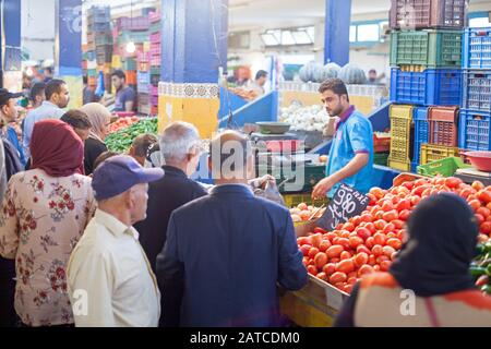 The crowded fruit and vegetable market in the Medina - Stock Photo