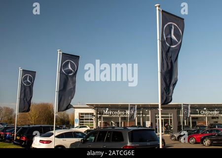 Chichester, West Sussex, UK, February 01, 2020, Mercedes Benz Banners fluttering in the wind at the Marshall Dealership. - Stock Photo