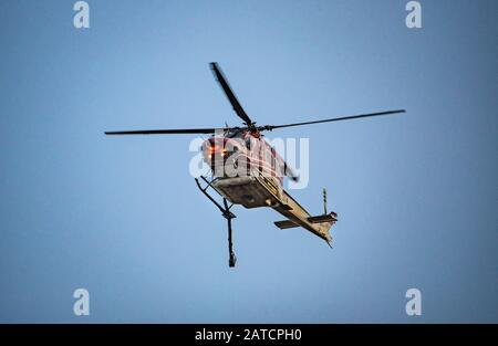 Orroral Valley Bushfire, Canberra, Australia, 01 Feb. 2020.  A Bell 412SP helicopter returning from water bombing the fire near Banks, Canberra. The Rural Fire Service of New South Wales are utilising a number of aircraft to combat the out of control fire. Credit: FoxTree gfx/Alamy Live News - Stock Photo