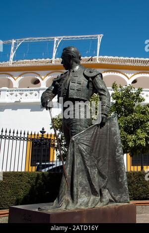 Sevilla Spain, statue  outside the bullring of Francisco Romero Lopez, better known as Curro Romero a famous torero from Seville - Stock Photo