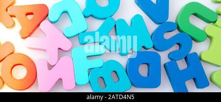 Colorful alphabet letter blocks scattered randomly on white background - Stock Photo