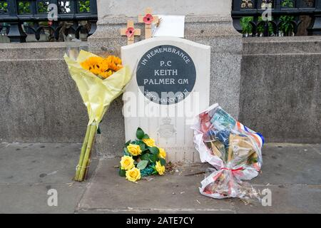 Westminster, London, UK. 26th June, 2019. Flowers are left in memory of PC Keith Palmer GM who was stabbed and died from his injuries during the Westminster Attack on 22nd March 2017 whilst at work at the House of Commons. Following his death he was posthumously awarded the George Medal which is the second highest award for gallantry 'not in the face of the enemy'. Credit: Maureen McLean/Alamy - Stock Photo