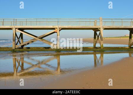 Detail of pier on the beach of Saint-Jean-de-Monts, a commune in the Vendée department in the Pays de la Loire region in western France - Stock Photo