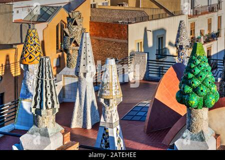 Chimneys on the rooftop terrace of Palau Guell mansion designed by architect Antoni Gaudi, Barcelona, Catalonia, Spain - Stock Photo
