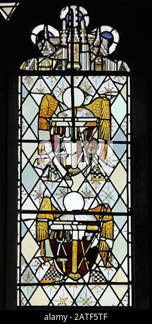 Reset fragments of 15th Century stained glass with Arma Christi, Collegiate Church of St Bartholomew, Tong, Shropshire - Stock Photo