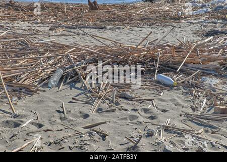 Spilled garbage on the beach of the big city. Empty used dirty plastic bottles. Dirty sea sandy shore the Black Sea. Environmental pollution. Ecologic - Stock Photo