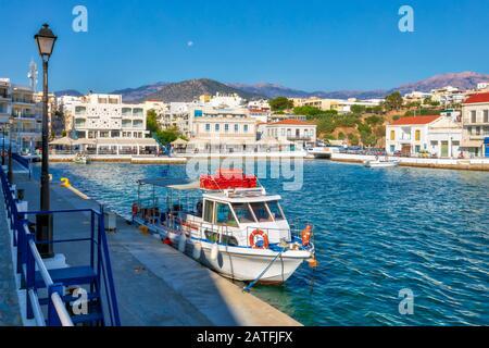 Morning view of Agios Nikolaos marina. Picturesque town of the island Crete, Greece. Image - Stock Photo