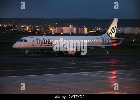 Flybe Embraer ERJ-190 at Belfast City Airport - Stock Photo