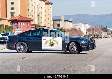 Jan 31, 2020 Santa Clara / CA / USA - Highway Patrol vehicle driving on a street in San Francisco Bay Area; The California Highway Patrol (CHP) is a s - Stock Photo