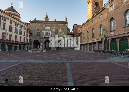 Panorama of Piazza Vecchia with the Contarini Fountain and in the background the Palazzo della Ragione in Piazza Vecchia in Bergamo Alta, Italy