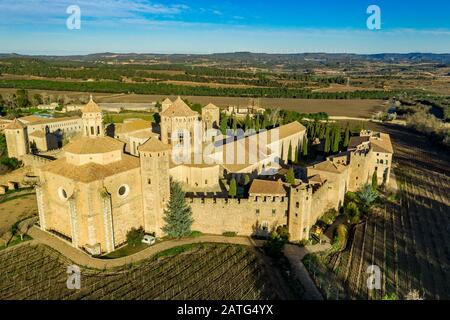 Aerial view of the Royal Abbey of Santa Maria de Poblet a Cistercian fortified monastery, founded in 1151 in Catalunya Spain - Stock Photo
