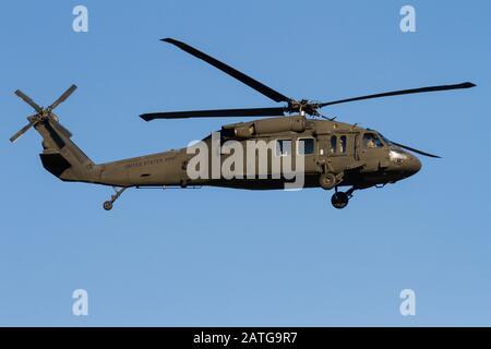 A US Army Sikorsky UH-60 Black Hawk helicopter coming in to land at Naval Air Facility, Atsugi near Yamato, Kanagawa, Japan. - Stock Photo