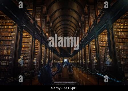 DUBLIN, IRELAND, DECEMBER 21, 2018: The Long Room in the Trinity College Library, home to The Book of Kells. Perspective view of the place, with large - Stock Photo