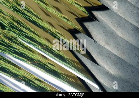 Urban abstraction: lines, angles and reflections in green, gray, black and white - Stock Photo