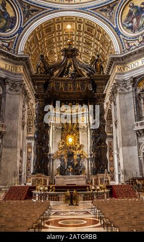 Inside St. Peters basilica looking at the Papal Altar area and Baldacchino, Vatican City, Rome, Italy