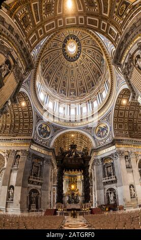 A very wide angle view inside St. Peters basilica looking at the Papal Altar area and Baldacchino beneath the great dome, Vatican City, Rome, Italy