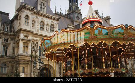 Old Carousel in movement near the city hall in Paris, France - Stock Photo