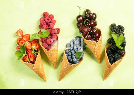 Selection of berries in ice cream cones - Stock Photo