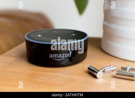 Echo Dot smart device from Amazon empowered by Artificial Intelligence (AI) - Stock Photo