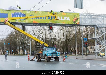 City Riga, Latvia. The crane is working on the street and changing the advertising. 03.02.2020 - Stock Photo