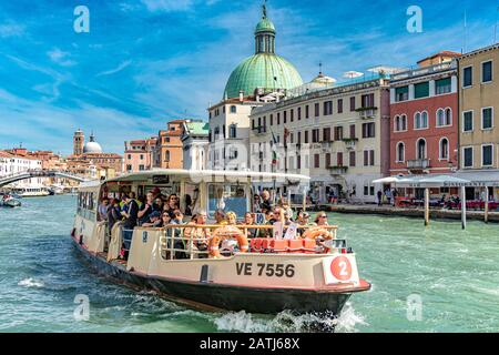 Passengers on board a Route  no 2 Vaporetto or water bus on The Grand Canal in Venice,Italy - Stock Photo