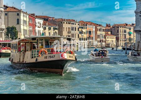 A Route No 2 Vaporetto or water bus making it's way along The Grand Canal in Venice Italy - Stock Photo