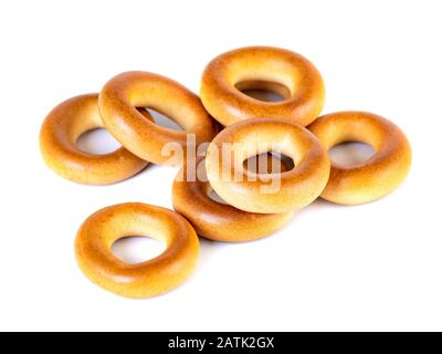 Small dry bagels, small rolls on a white background - Stock Photo