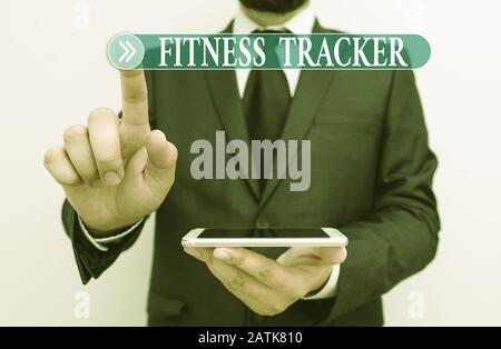 Word writing text Fitness Tracker. Business photo showcasing device that records a demonstratings daily physical activity Male human wear formal work - Stock Photo