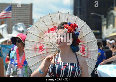A participant is seen posing for a photo during the annual Mermaid day parade in Coney Island, Brooklyn on June 22, 2019. - Stock Photo