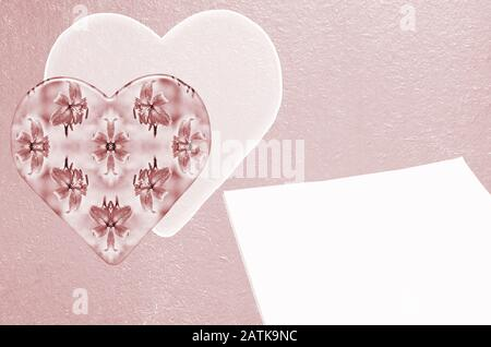 Hearts and blank paper on a textured wooden background. Painted in pink - Stock Photo