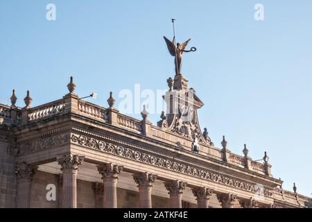 The statue of Victory on the facade of the State Government Palace and Museum or Palacio de Gobierno del Estado de Nuevo Leon in the Macroplaza Grand Plaza alongside the Barrio Antiguo neighborhood of Monterrey, Nuevo Leon, Mexico.