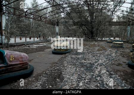abandoned old amusement park in the city of Pripyat Chernobyl, Ukraine, exclusion zone - Stock Photo