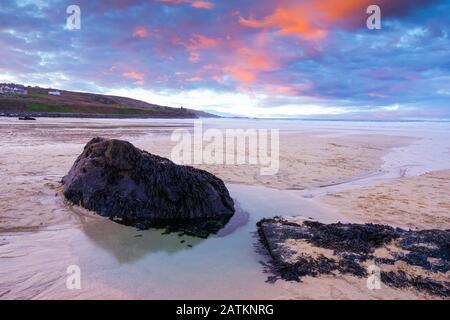 Vibrant sunset on the golden sand at Porthmeor Beach St Ives Cornwall England UK Europe