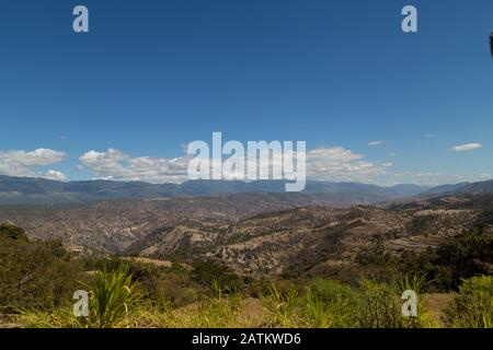 mountains with few trees due to deforestation and climate change - Stock Photo
