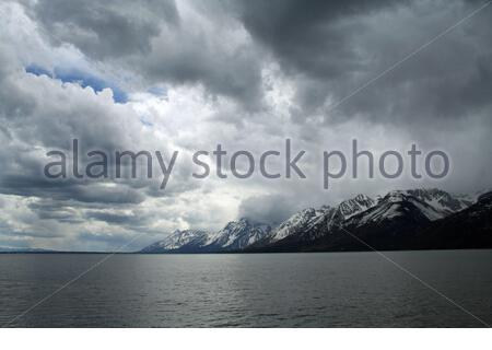 An incoming thunderstorm over Jackson Lake in Grand Teton National Park. - Stock Photo