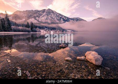 Alpine lake Grundlsee with fantastic reflection on the water surface in Winter - Stock Photo