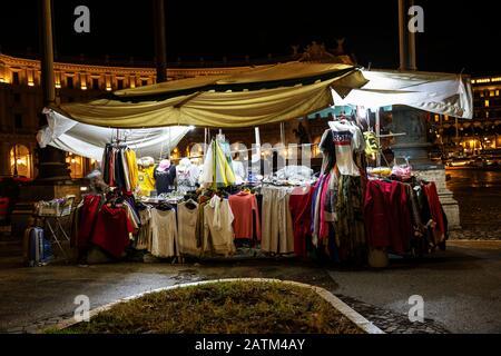 Clothes Market on the street, at night in Piazza della Repubblica Rome Italy. - Stock Photo