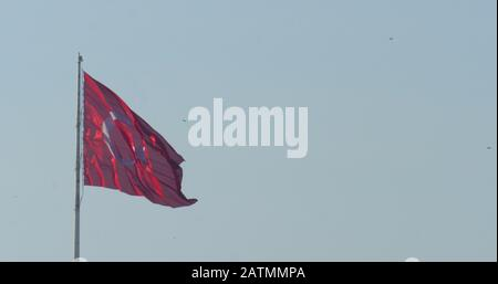 Turkish flag waving at blue sky and birds flying on the background. Turkey. - Stock Photo