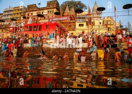 people at the Ganges in Varanasi - Stock Photo