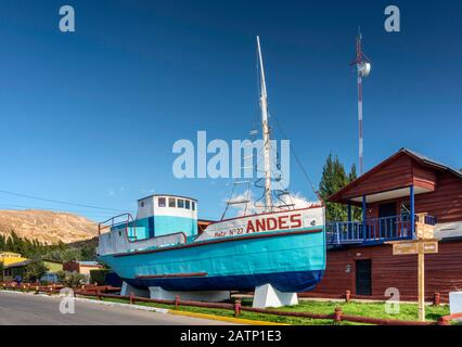 Los Andes vessel, displayed in center of Chile Chico, town on south shore of Lago General Carrera, Patagonia, Chile - Stock Photo