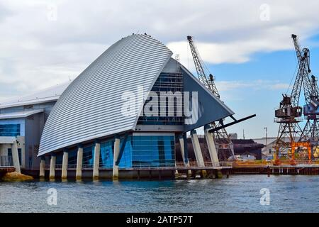 Perth, WA, Australia - November 27, 2017: Maritime museum and cranes on Swan River in Fremantle - Stock Photo