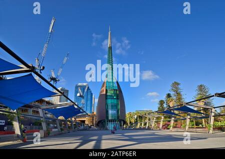 Perth, WA, Australia - November 27, 2017: The Bell Tower, landmark in the capital of Western Australia and construction activity for hotels nearby - Stock Photo
