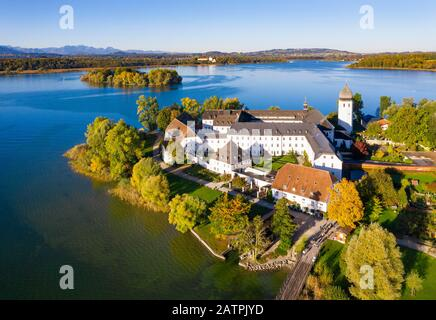 Benedictine monastery Frauenwoerth on Fraueninsel, Frauenchiemsee, behind Krautinsel and Herreninsel, Chiemsee, Alps, Chiemgau, aerial view - Stock Photo