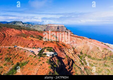 Viewpoint Mirador de Abrante with Skywalk, eroded mountain slope with red earth, near Agulo, drone photo, La Gomera, Canary Islands, Spain - Stock Photo